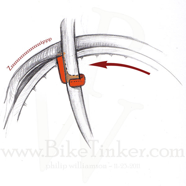 crude drawing of a tire being demounted with the cobra tire tool
